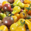 Stock Photo: Purple, yellow, orange & green baby bell peppers