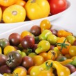 Stock Photo: Variety of organic heirloom tomatoes