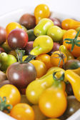 Purple, yellow, orange & green baby bell peppers — Stock Photo