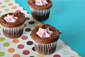 Shot of polka dot raspberry filled cupcakes — Stock Photo