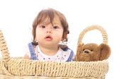 Baby in basket with teddy — Stock Photo