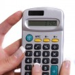 Royalty-Free Stock Photo: Calculator and hand