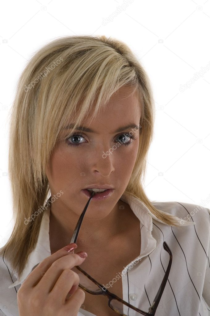 An attractive blonde business woman with glasses in mouth — Stock Photo #3462705