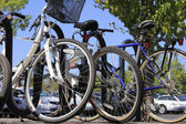 Bikes and cars at a park and ride — Stock Photo