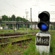Blue signal lamp beside the railway — Stock Photo