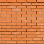 textura y fondo de pared de ladrillo luz naranja — Foto de Stock