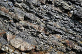 Sedimentary Rocks in mountains background or texture — Stock Photo