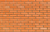 Light orange brick wall background and texture — Stock Photo
