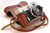 Used old-fashioned film photo-camera in leather case — Stock Photo