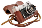 Isolated used old-fashioned film photo-camera in leather case — Stock Photo
