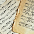Old music sheet pages background — Stock Photo #3772491