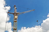 Old rusty crane and sky — Stock Photo