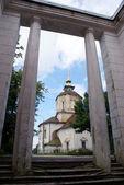 Columns and church — Stock Photo