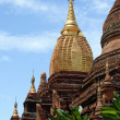 Stock Photo: Brick pagodwith golden spire