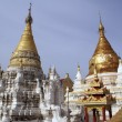 Stock Photo: Golden stupas