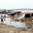 Stock Photo: Slum on river