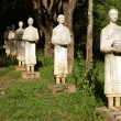 Statues of buddhist monk in the forest, Hsipo, Myanmar — Stock Photo #3617896