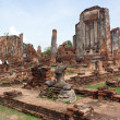 Ruins and sittung Buddha - Stock Photo