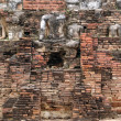 Brick wall and Buddhas — Stock Photo #3619084