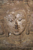 Wall and face of Buddha — Stock Photo