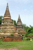 Brick stupas and green grass — Stock Photo