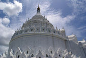 Clouds and white pagoda — Stock Photo