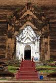 Entrance of brick stupa — Stock Photo