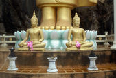 Two Buddhas and legs — Stock Photo