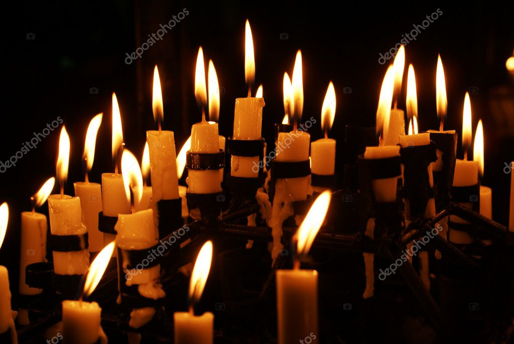 Candles and fire in the christian cathedral                        Stock Photo #3619956