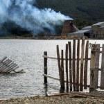 Lake and sawmill — Stock Photo