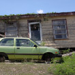 Car and house — Stock Photo