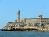 Lighthouse and fort — Stock Photo