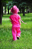 Little fashionable girl all in pink walking — Stock Photo