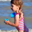 图库照片: Little preschooler girl beach portrait