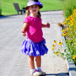 Little cute girl standing in the park — Stock Photo