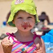 Little girl in sunglasses eating ice cream — Stock Photo #3628646
