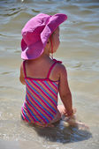 Little toddler girl on the beach — Stock Photo