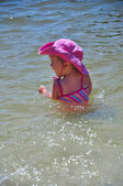 Little toddler girl playing in the water — Stock Photo