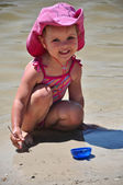 Little toddler girl playing on the beach — Stock Photo