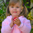 Stock Photo: Portrait of the beautiful girl holding an apple