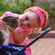 Girl playing with old cat - Stock Photo