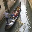 Traditional Venice gondola ride — Stock Photo