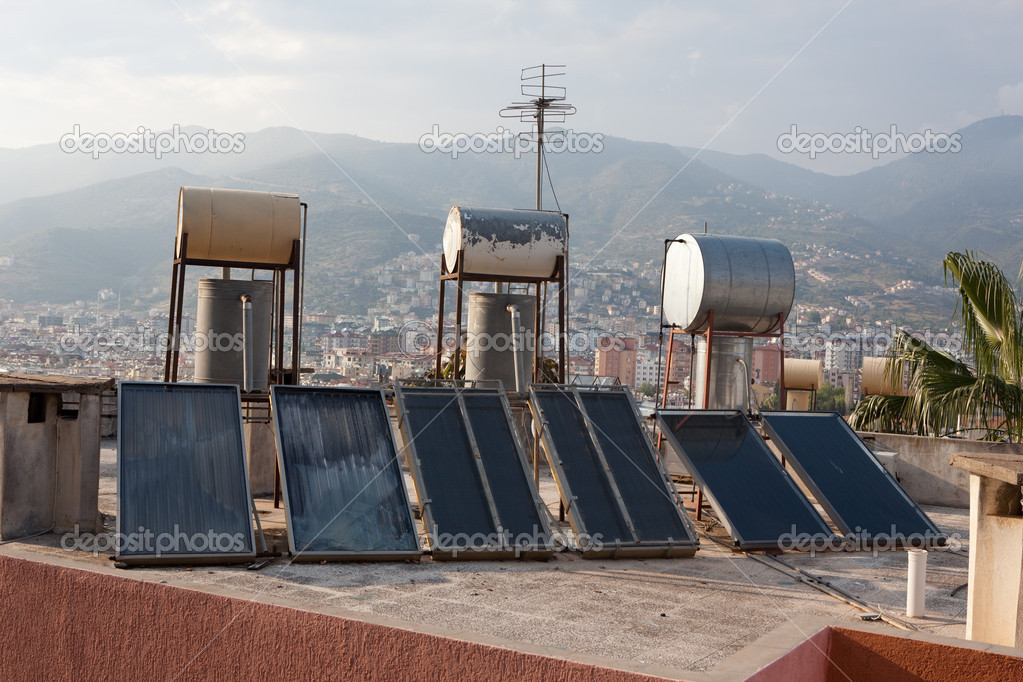Sollar thermal collectors for water heating on the roofs of Alanya, Turkey  Stock Photo #3498317