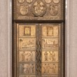 Stock Photo: Bronze door at Vilnius University