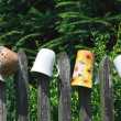 Cups on fence - Stock Photo