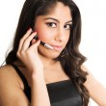 Beautiful girl speaking in headset — Stock Photo