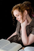 Beautiful girl with red hair reading a book — Stock Photo