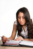 Beautiful girl focused on her planner — Stock Photo