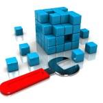 chave inglesa e cubo puzzle — Foto Stock