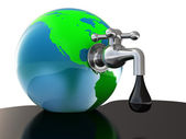 Oil faucet in earth globe — Stock Photo